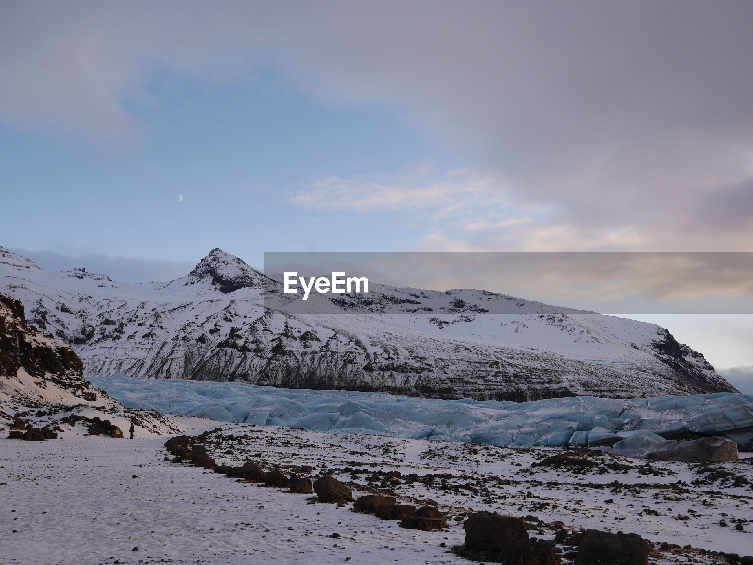 Idyllic shot of glacier against cloudy sky