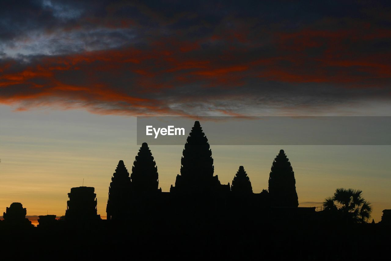 sunset, architecture, silhouette, religion, orange color, spirituality, place of worship, built structure, building exterior, sky, no people, tree, travel destinations, outdoors, nature, ancient civilization