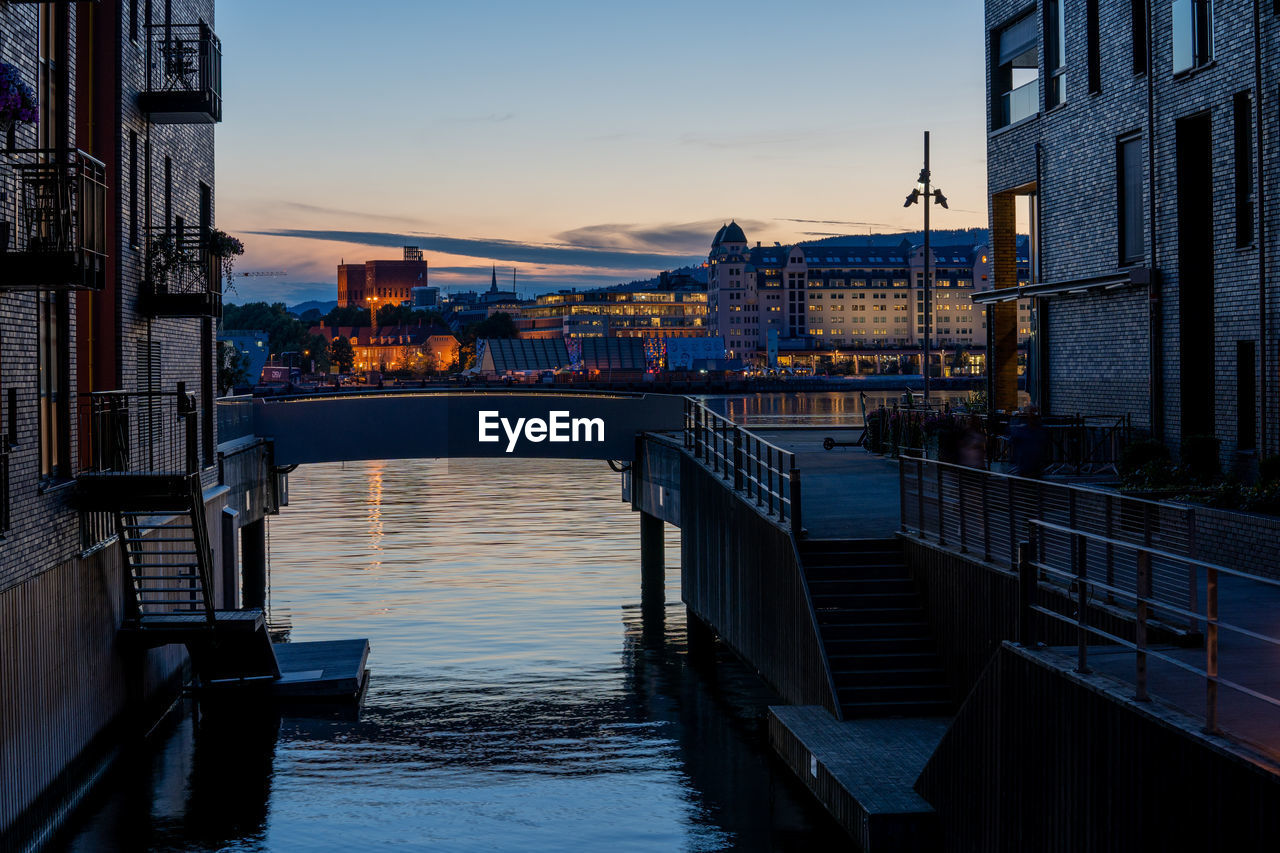 architecture, built structure, water, sky, sunset, building exterior, city, nature, transportation, reflection, connection, no people, railing, nautical vessel, dusk, river, cloud - sky, illuminated, outdoors