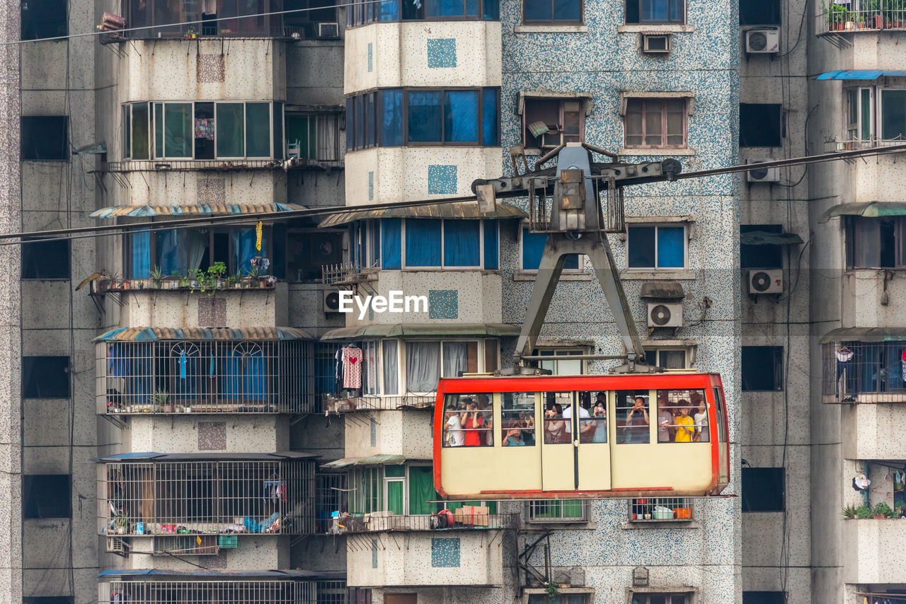 Overhead Cable Car Against Buildings In City