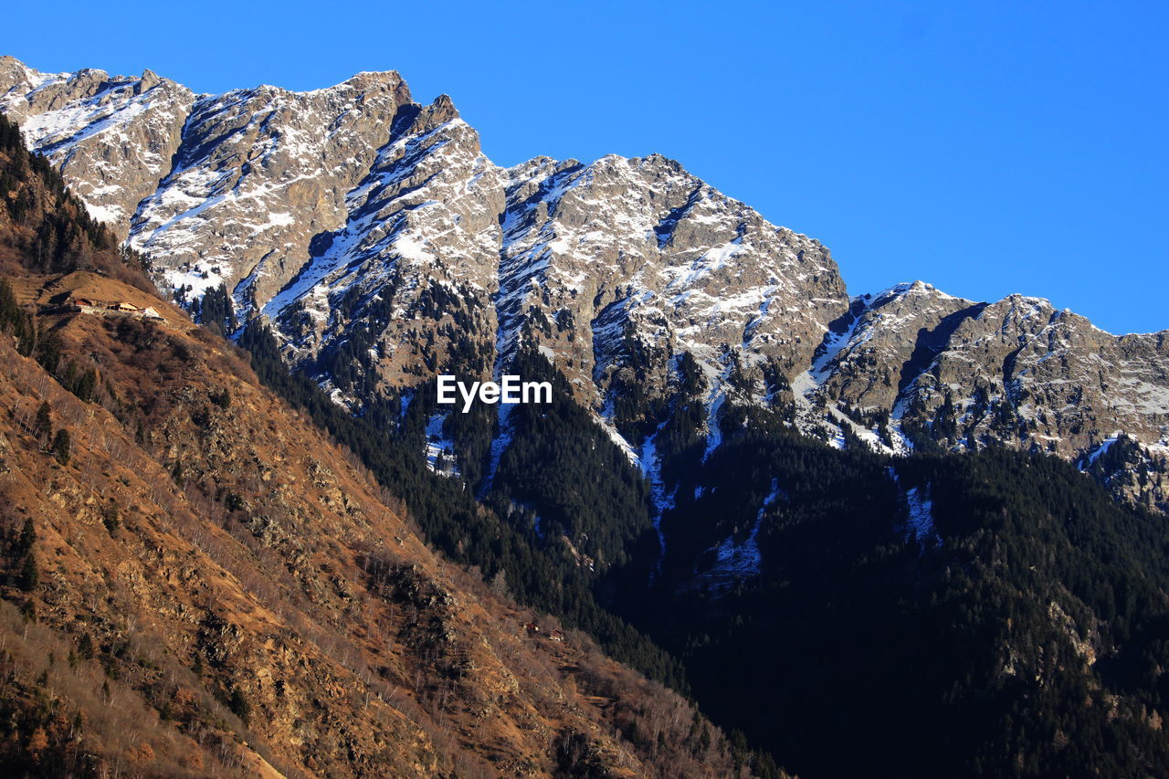 mountain, scenics - nature, mountain range, beauty in nature, sky, tranquility, tranquil scene, cold temperature, blue, winter, nature, day, no people, snow, clear sky, snowcapped mountain, non-urban scene, rock, physical geography, mountain peak, formation, outdoors