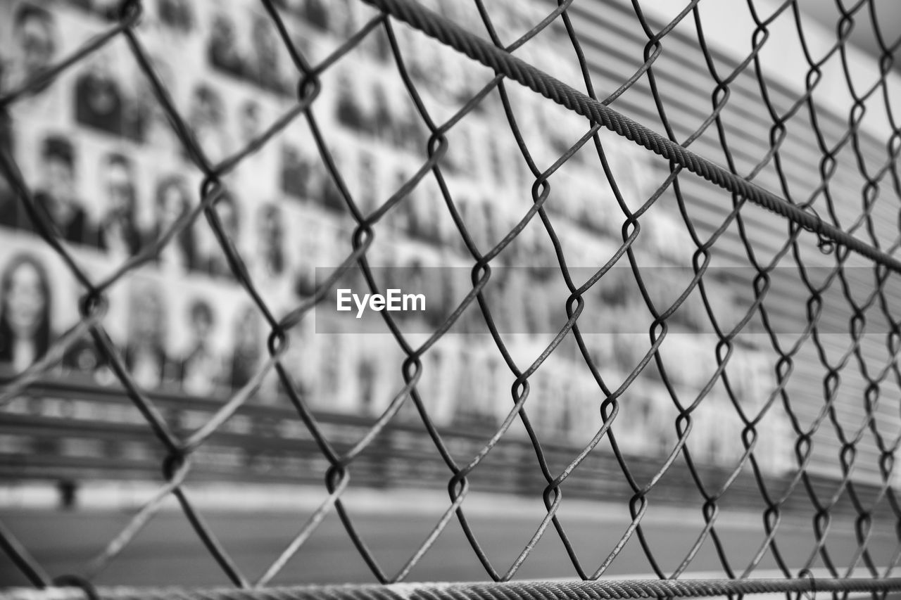 chainlink fence, protection, safety, metal, chainlink, security, full frame, pattern, day, no people, outdoors, close-up, focus on foreground, backgrounds, crisscross, city, nature, water, sky