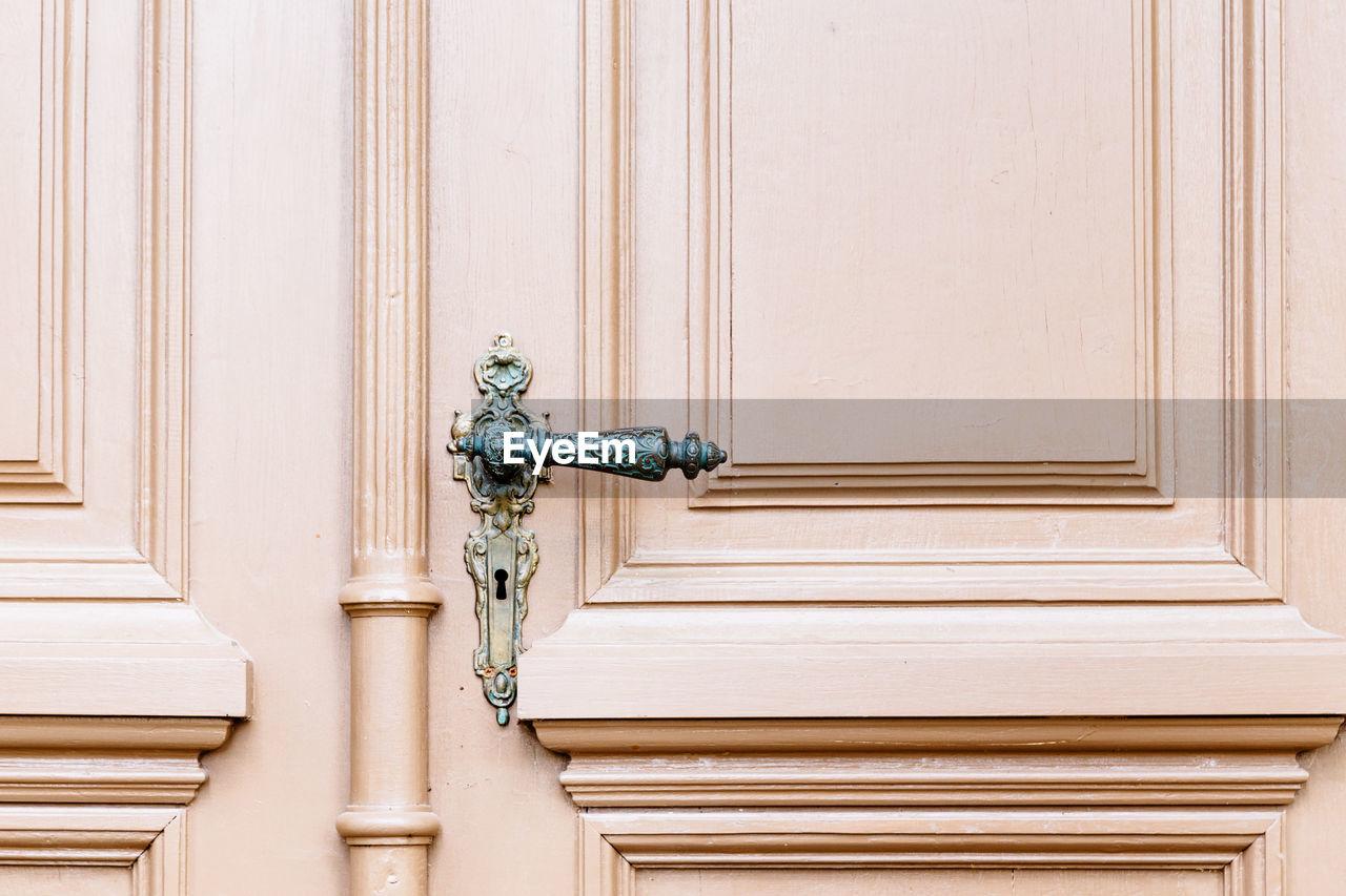 Close up pink door with door handle