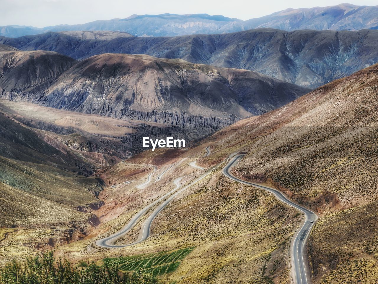 mountain, landscape, scenics - nature, environment, mountain range, non-urban scene, beauty in nature, road, no people, tranquility, tranquil scene, nature, day, remote, winding road, geology, transportation, mountain road, physical geography, idyllic, arid climate, outdoors, climate, formation