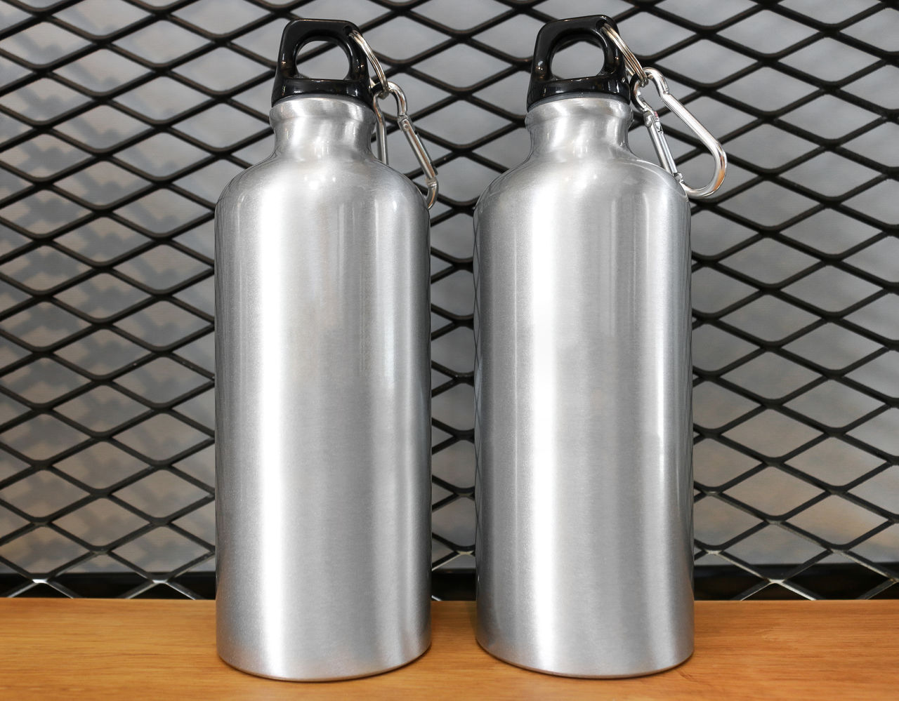 metal, indoors, silver colored, no people, close-up, still life, two objects, pattern, alloy, container, table, technology, steel, food and drink, single object, bottle, design, empty, equipment, silver - metal