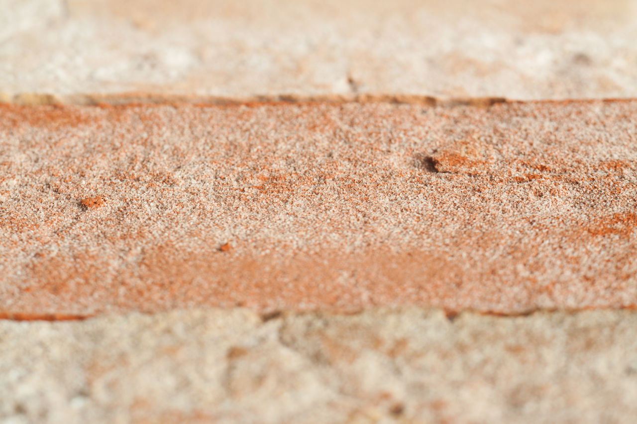 selective focus, close-up, no people, textured, full frame, backgrounds, rough, brown, wall - building feature, day, outdoors, sand, nature, still life, pattern, land, beige, built structure, wall, concrete