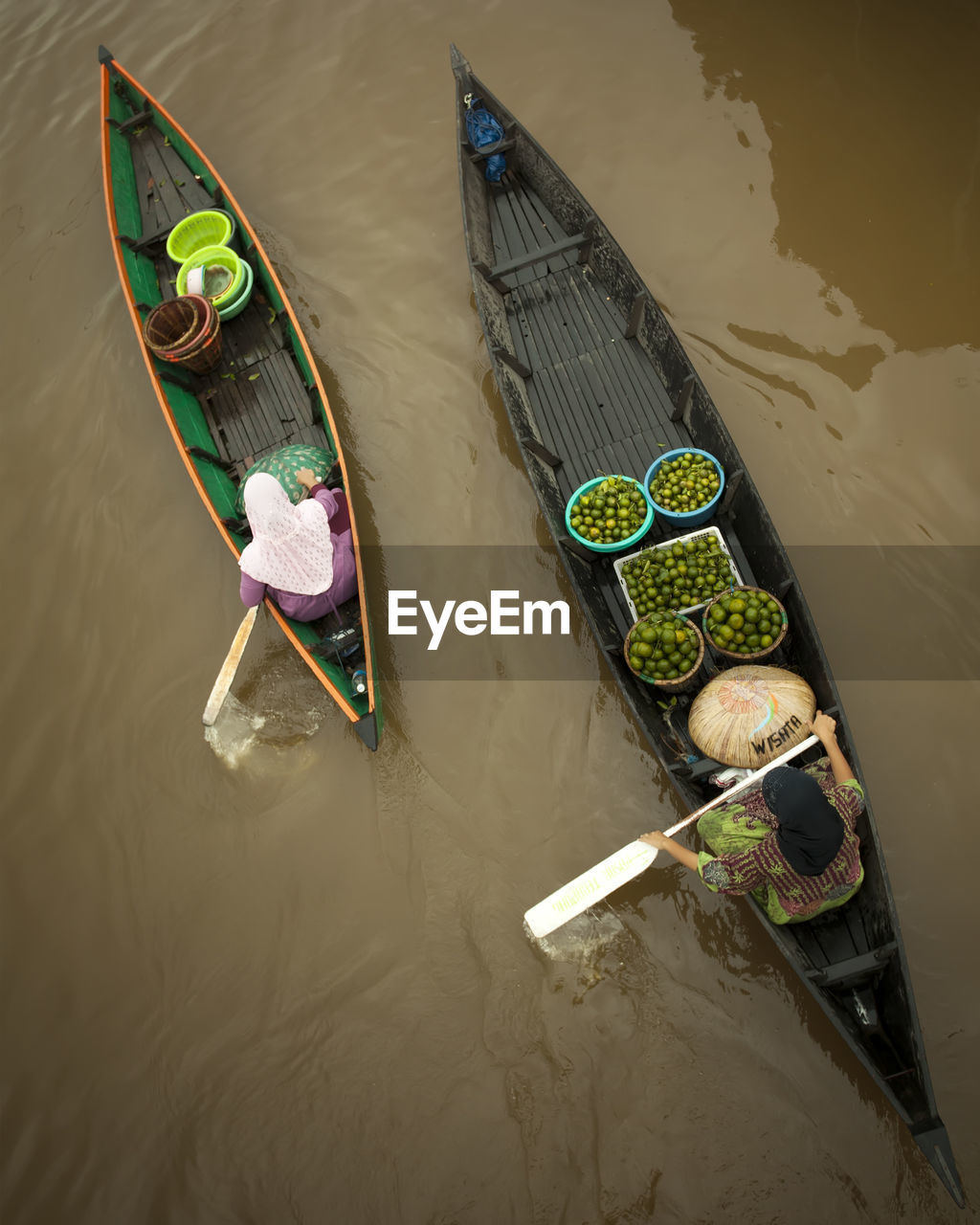 high angle view, nautical vessel, water, transportation, mode of transportation, nature, real people, day, occupation, men, outdoors, one person, waterfront, oar, river, moored