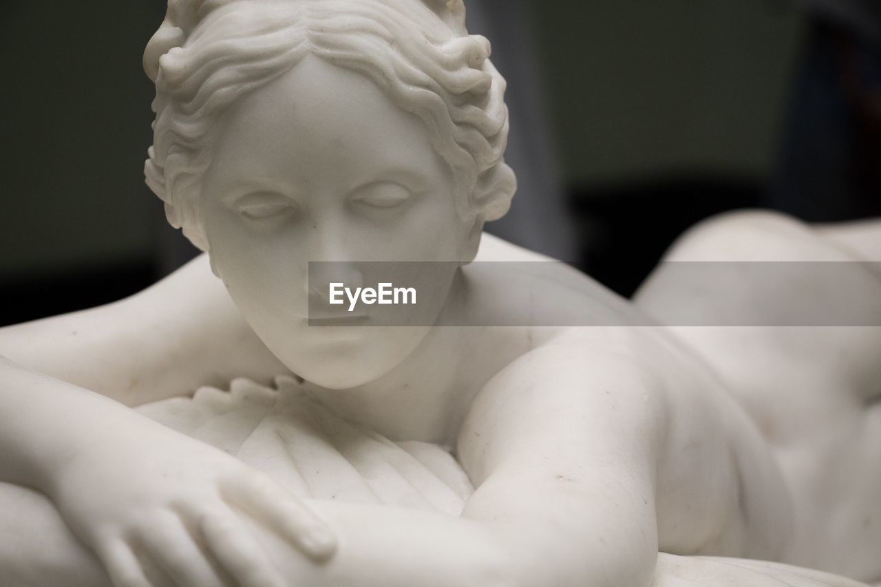 sculpture, representation, art and craft, statue, human representation, indoors, shirtless, male likeness, close-up, creativity, people, female likeness, focus on foreground, lifestyles, headshot, white color, selective focus, portrait, craft