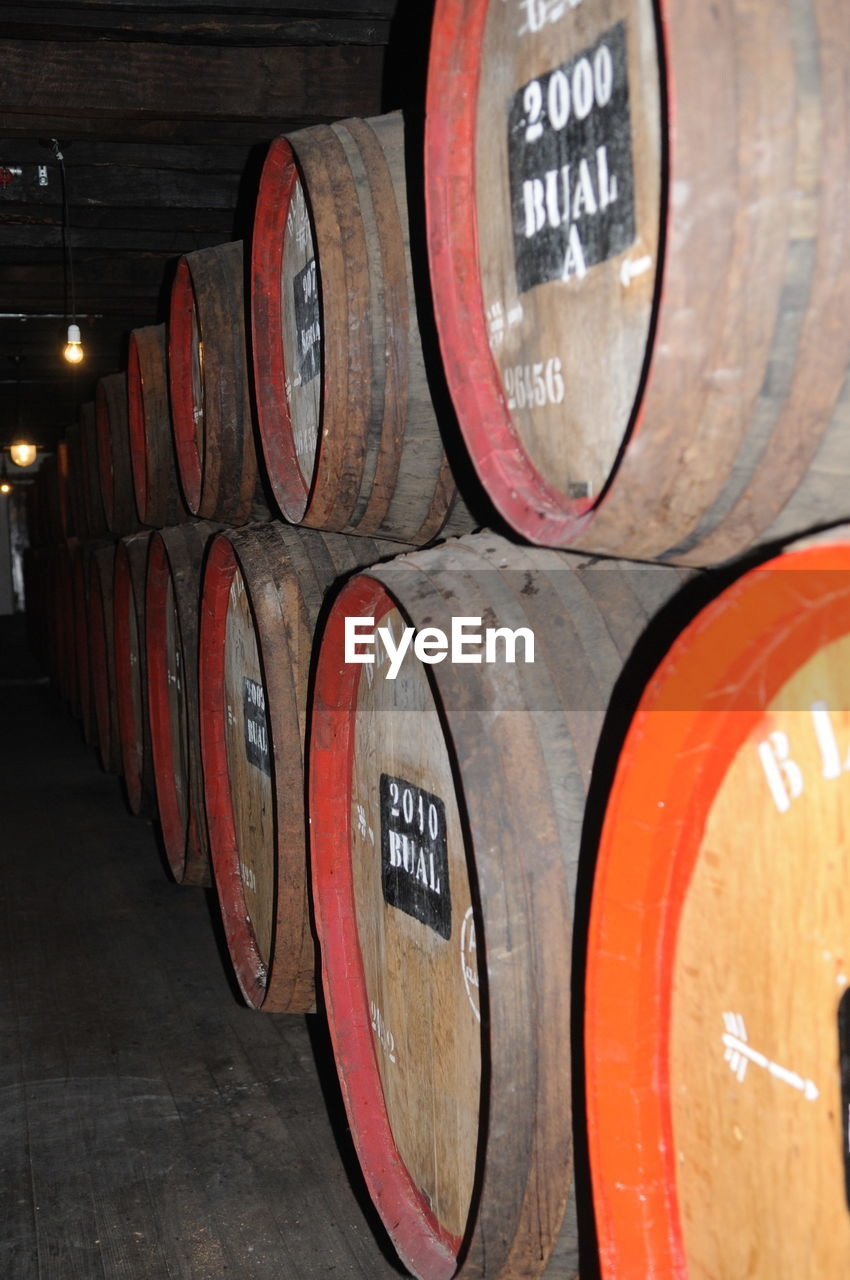 barrel, wine cask, wine cellar, winery, wine, wood - material, text, in a row, winemaking, alcohol, cellar, no people, indoors, food and drink industry, drink, food and drink, stack, keg, close-up, day