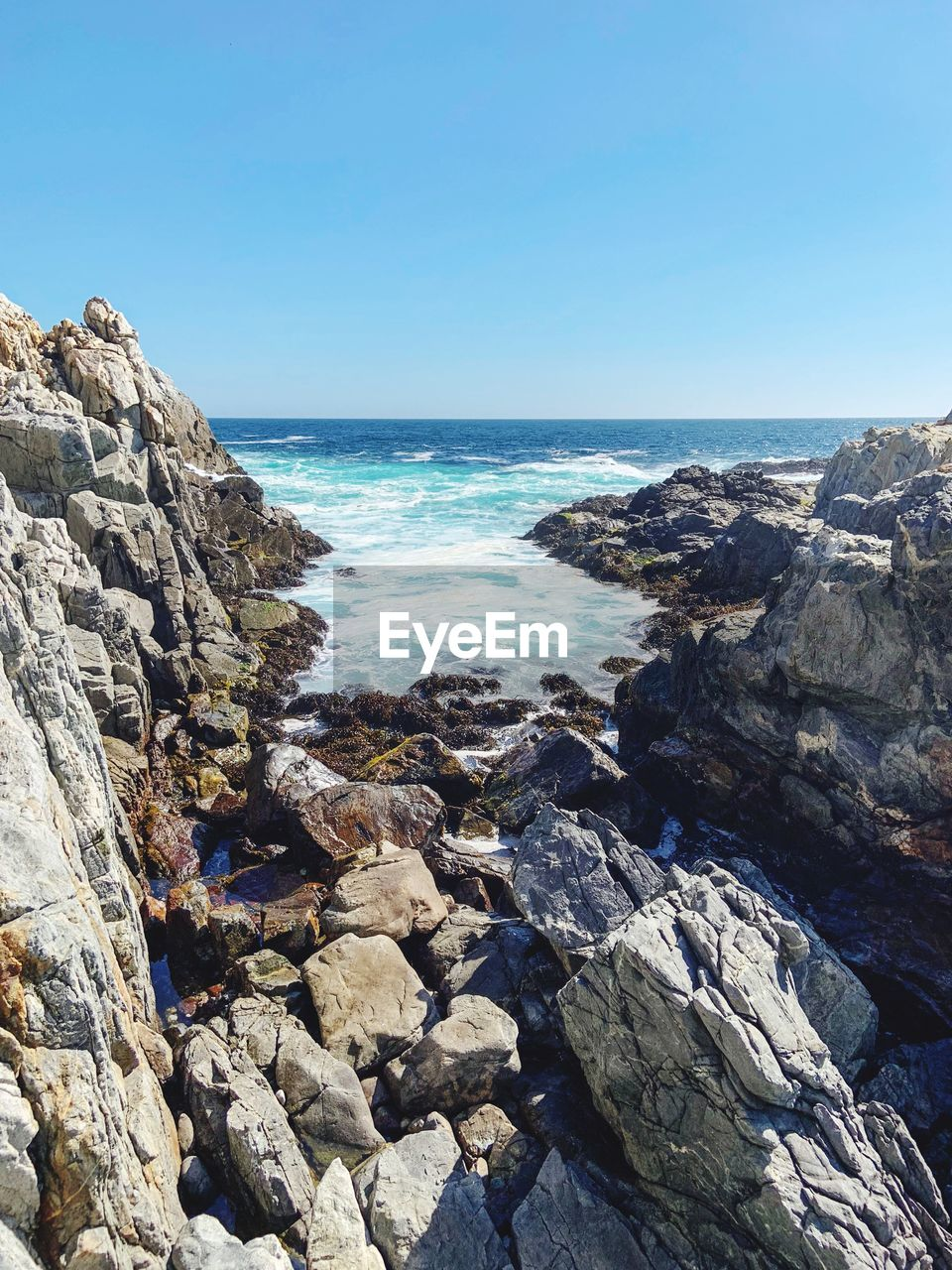 sea, water, rock, sky, solid, rock - object, horizon, horizon over water, beauty in nature, scenics - nature, clear sky, nature, land, beach, day, tranquil scene, blue, tranquility, no people, outdoors, rocky coastline, pebble