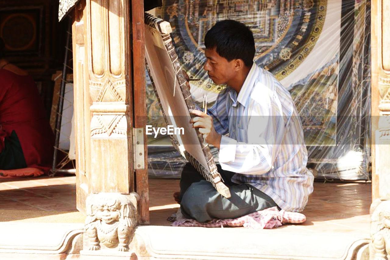 Man Painting At Workshop