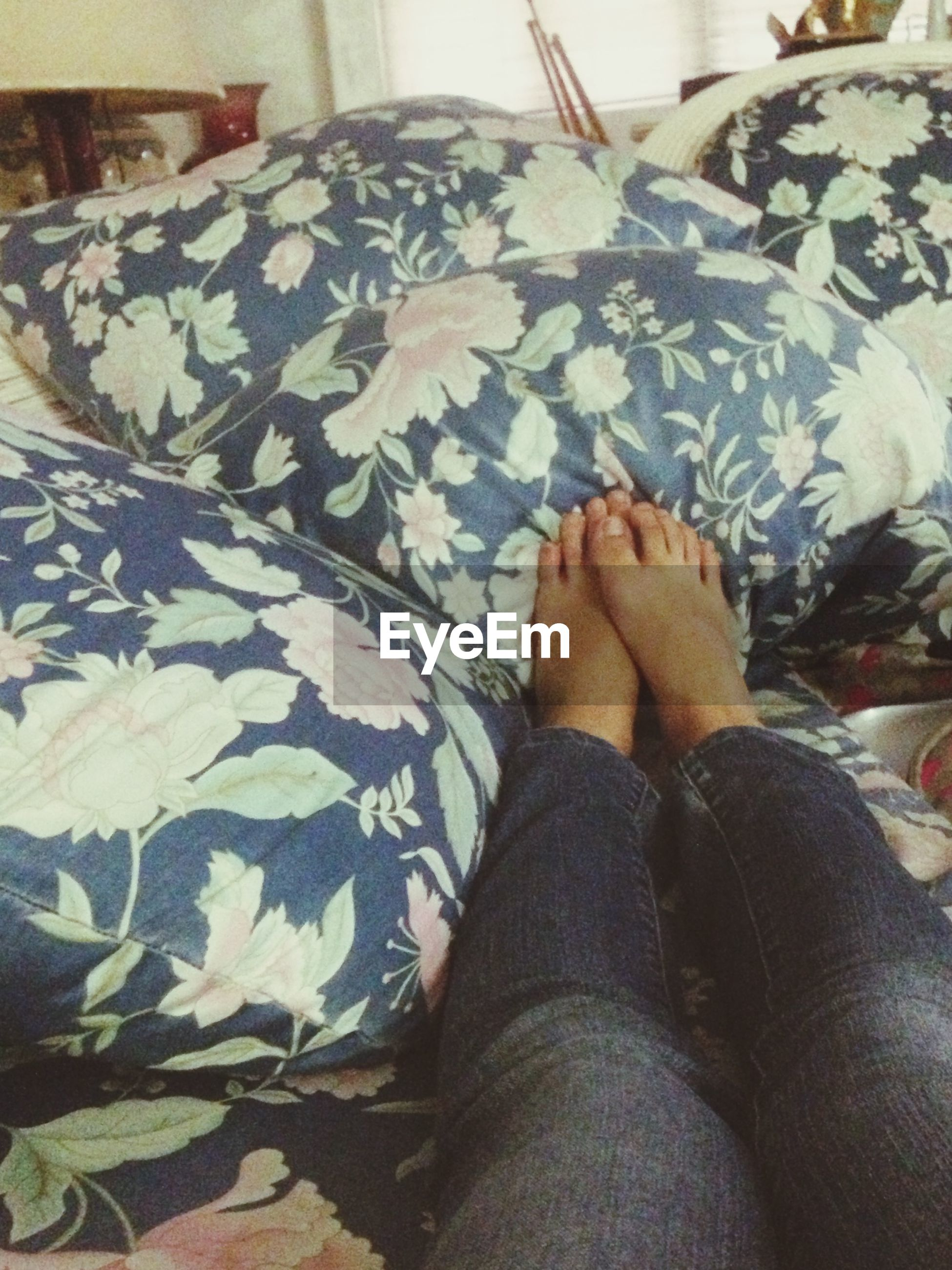 low section, person, indoors, relaxation, bed, personal perspective, human foot, barefoot, lifestyles, high angle view, resting, jeans, sitting, leisure activity, home interior, lying down