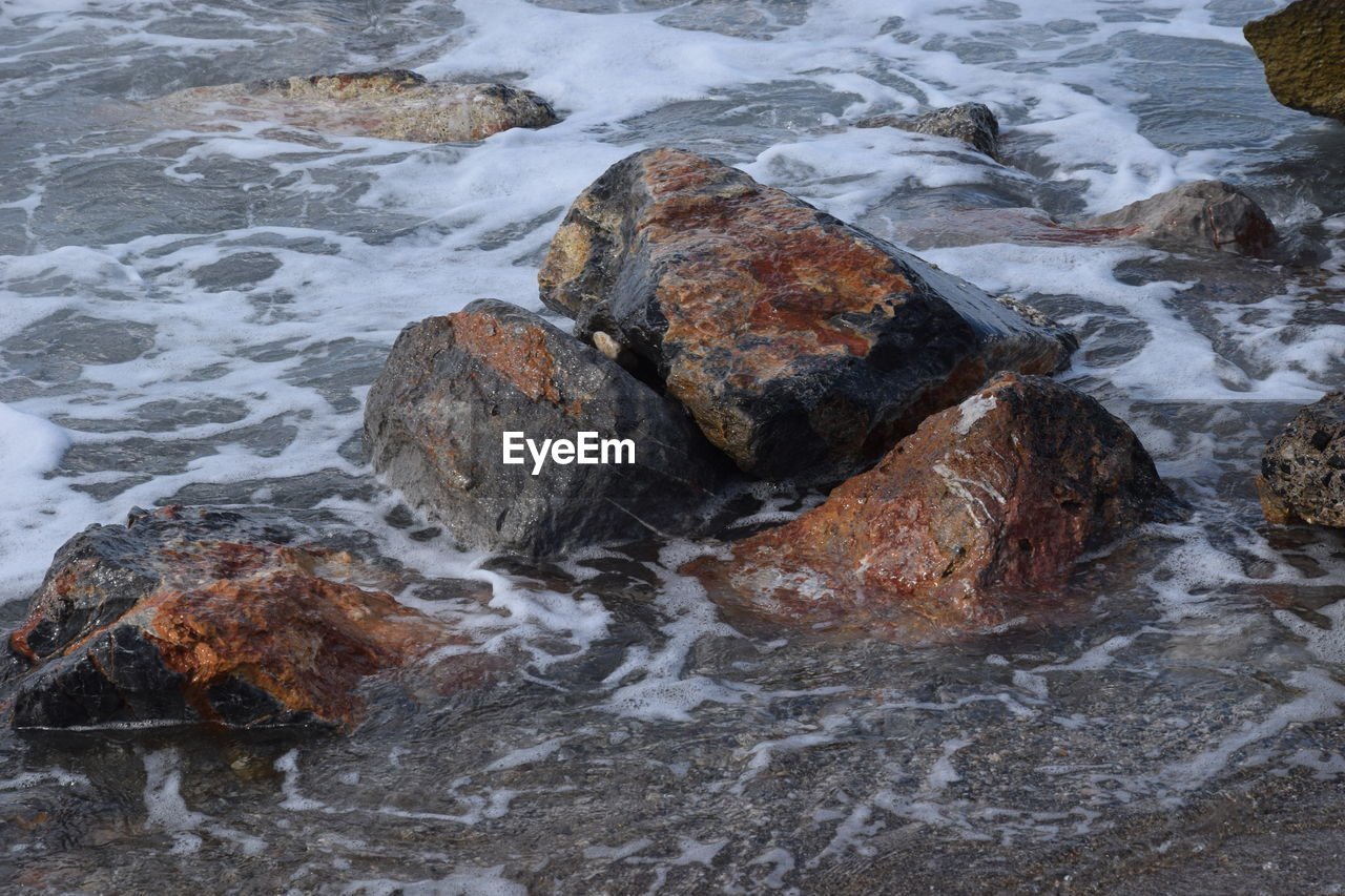 rock - object, water, nature, no people, day, waterfront, high angle view, sea, beauty in nature, outdoors, motion, wave