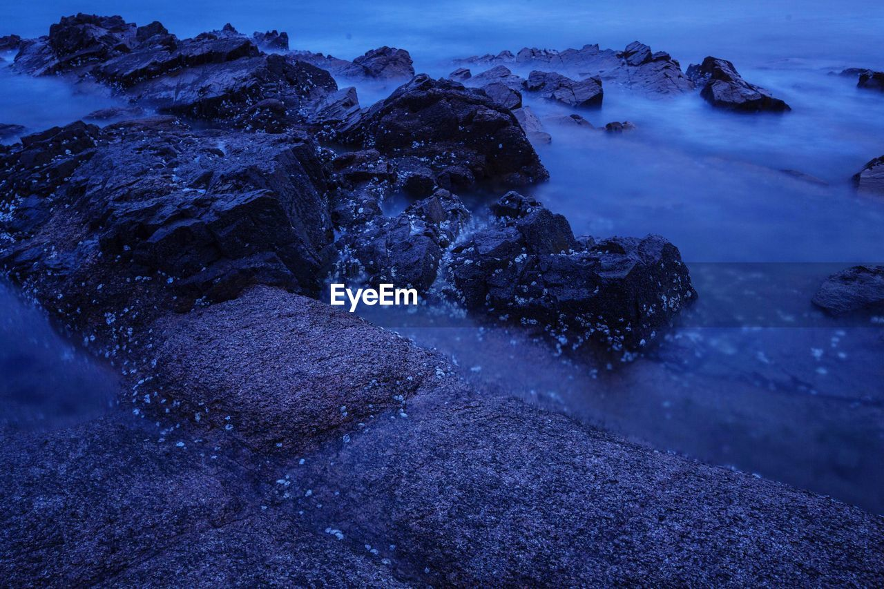 rock - object, nature, water, beauty in nature, no people, blue, tranquility, outdoors, scenics, landscape, sea, day, sky, hot spring
