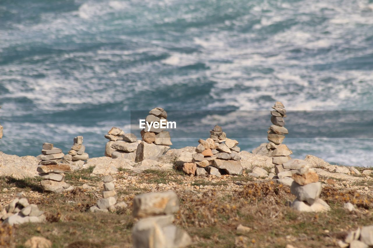 selective focus, day, nature, rock, solid, no people, mountain, tranquility, land, stone, scenics - nature, history, tranquil scene, water, outdoors, beauty in nature, sea, rock - object, the past, balance