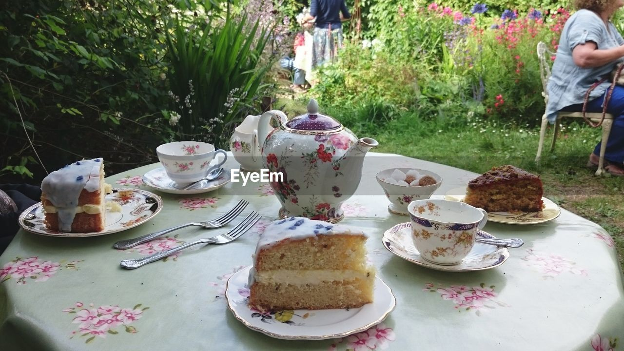 food and drink, table, saucer, food, plate, dessert, cake, refreshment, drink, sweet food, coffee cup, tea - hot drink, coffee - drink, freshness, teapot, unhealthy eating, indulgence, temptation, day, outdoors, ready-to-eat, friendship, close-up, no people