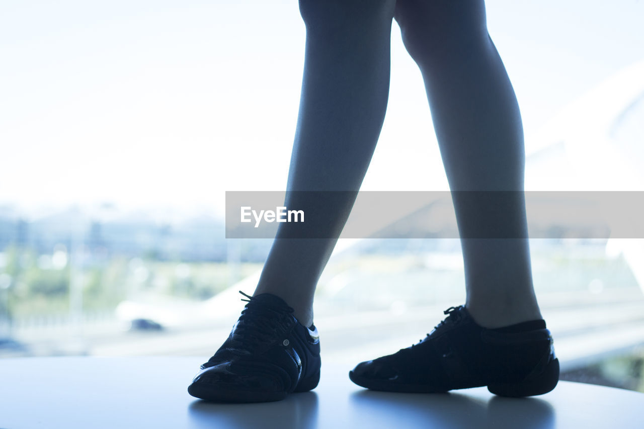 human leg, one person, low section, human body part, body part, shoe, real people, lifestyles, day, standing, focus on foreground, unrecognizable person, adult, fashion, outdoors, women, limb, human limb, human foot