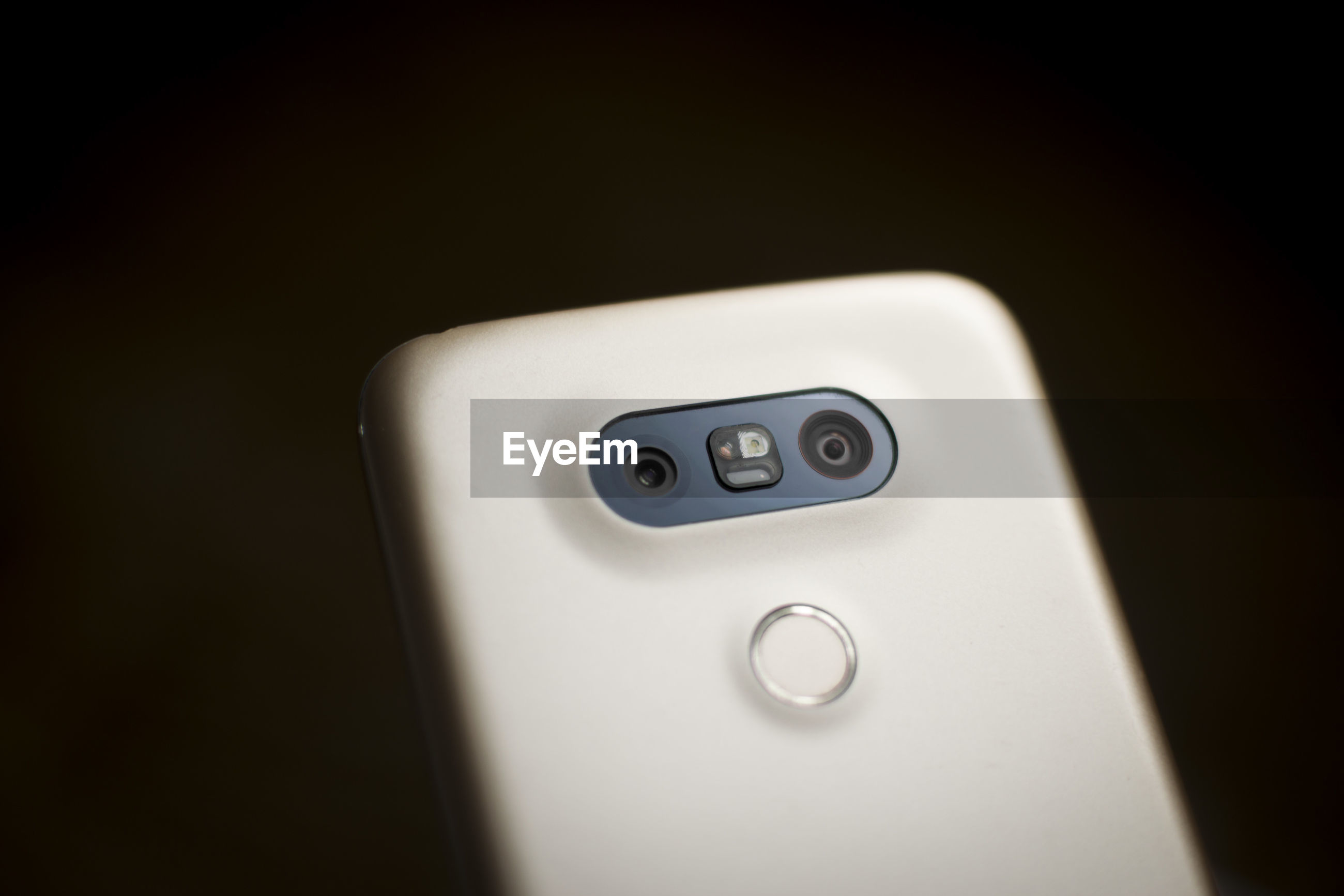 Close-up of smart phone against black background