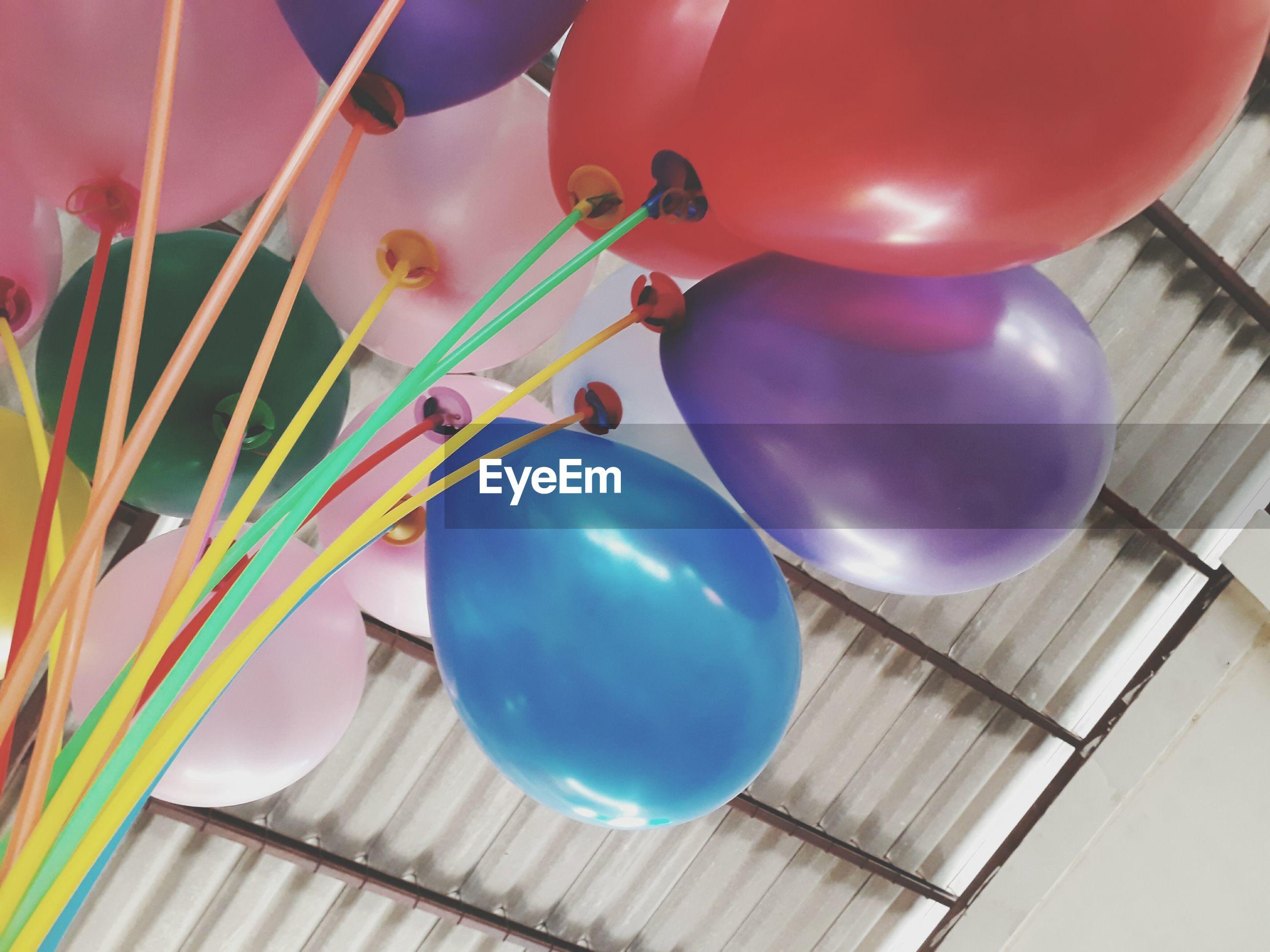 balloon, helium balloon, celebration, no people, multi colored, fragility, helium, indoors, day