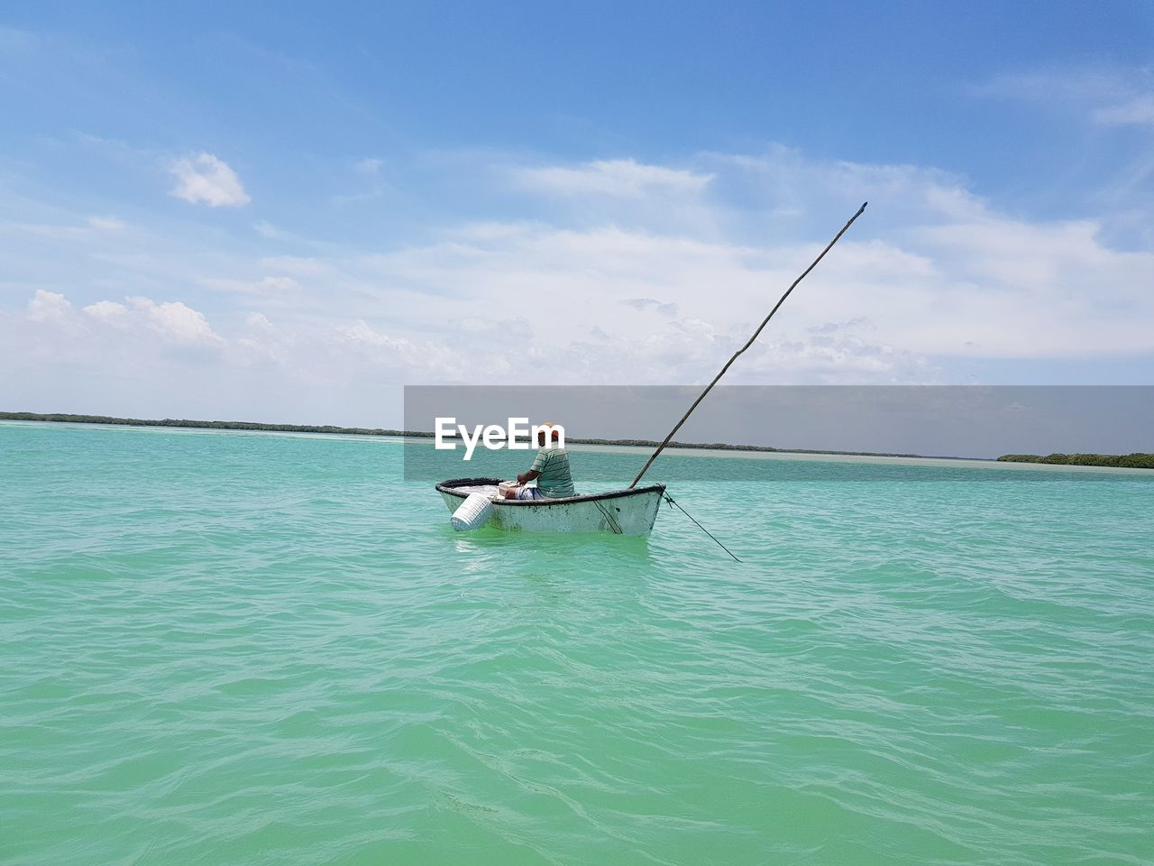 Man On Boat In Sea Against Sky