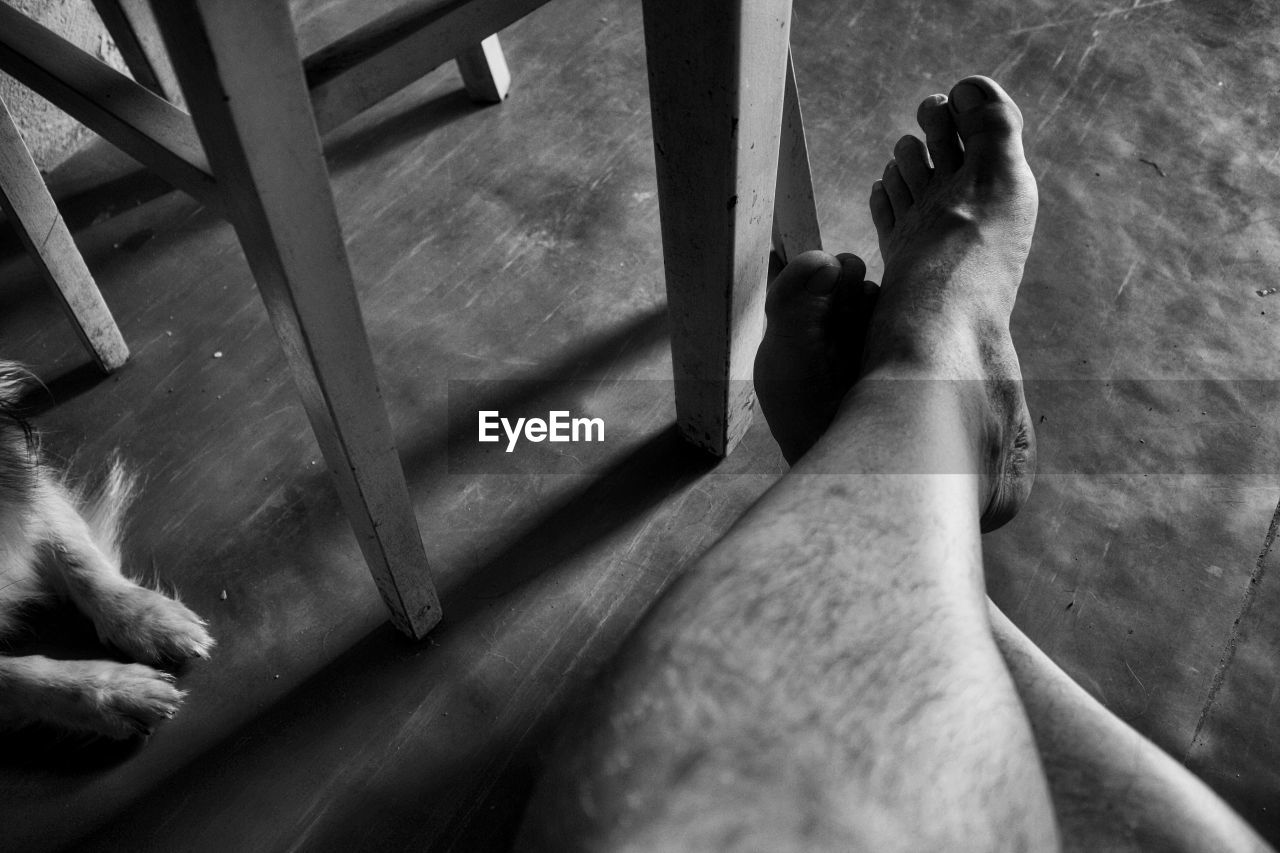 human body part, body part, low section, human leg, real people, high angle view, personal perspective, barefoot, men, human foot, people, day, lifestyles, two people, architecture, indoors, relaxation, leisure activity, human limb