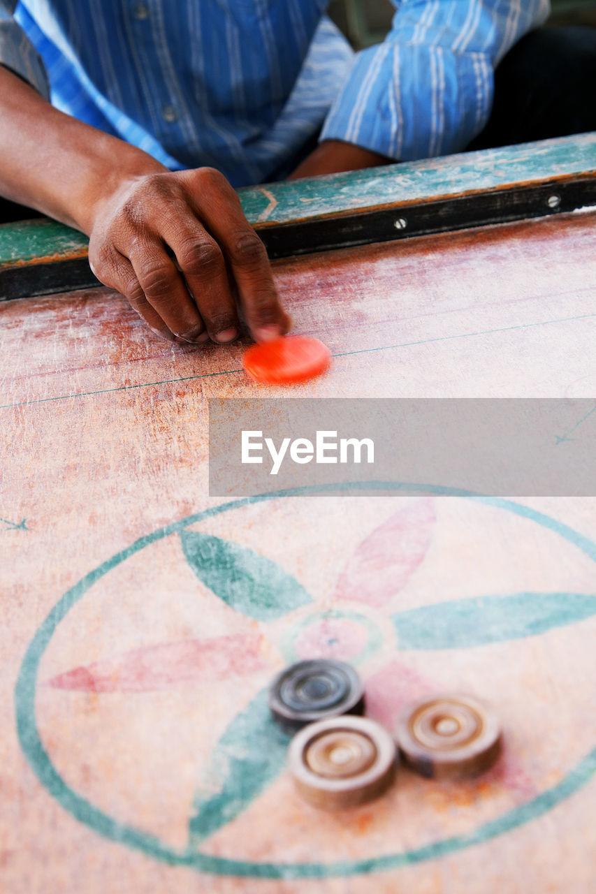 Detail Shot Of Playing Carom Board