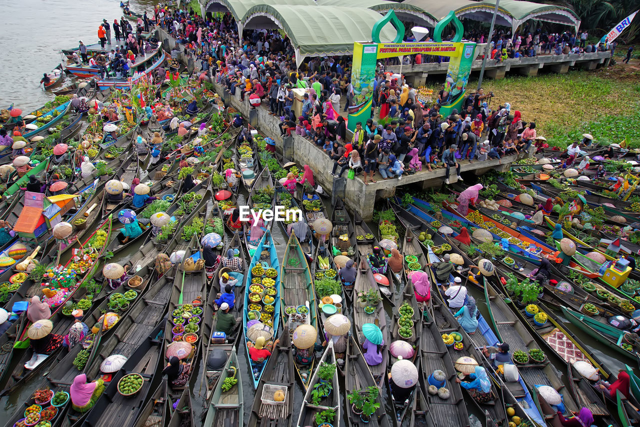 crowd, multi colored, large group of people, high angle view, group of people, real people, day, transportation, choice, celebration, architecture, women, men, mode of transportation, variation, event, large group of objects, outdoors, festival