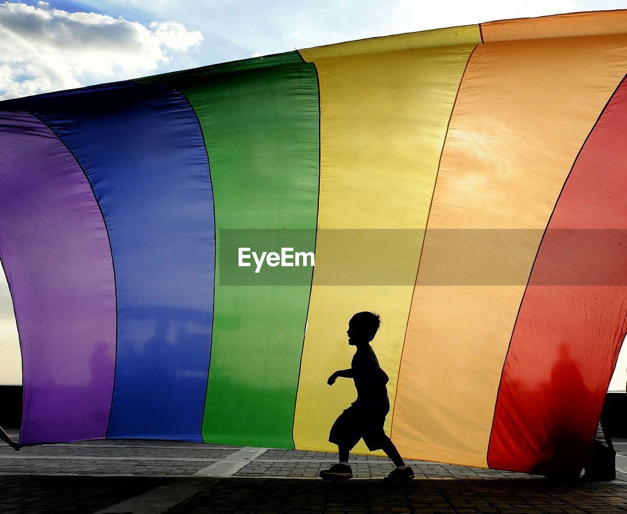 Full length of child against rainbow flag