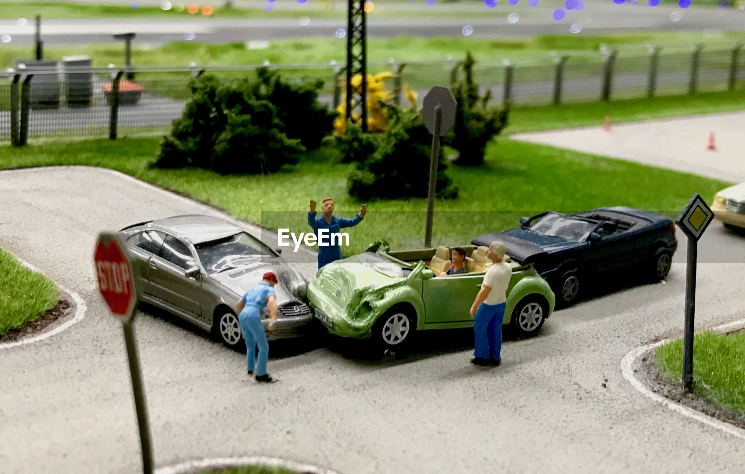 High angle view of toy cars and figurines