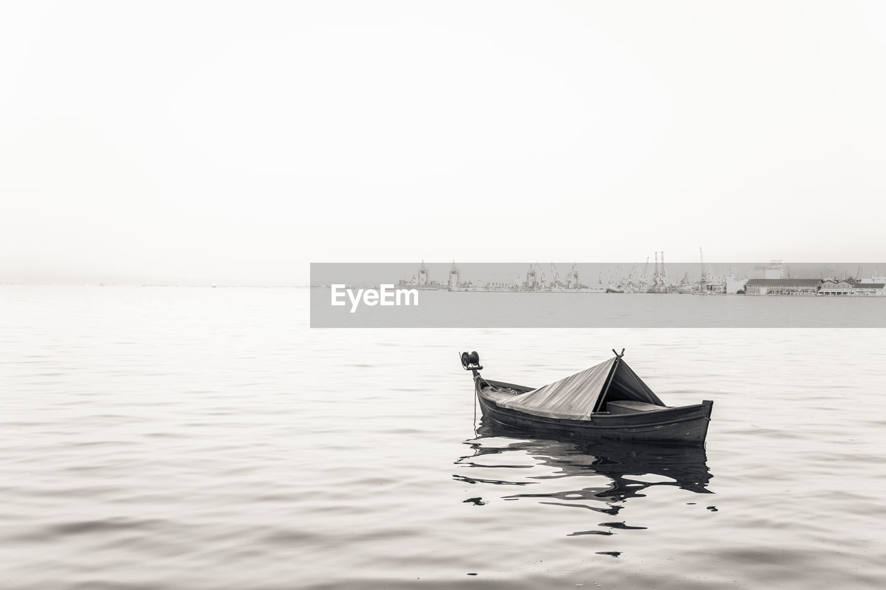 Boat In Sea Against Clear Sky