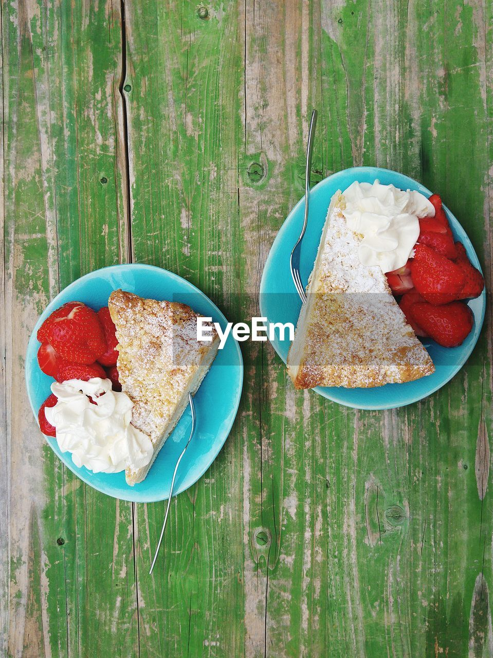 Directly Above Shot Of Cake Slice With Cream And Strawberries