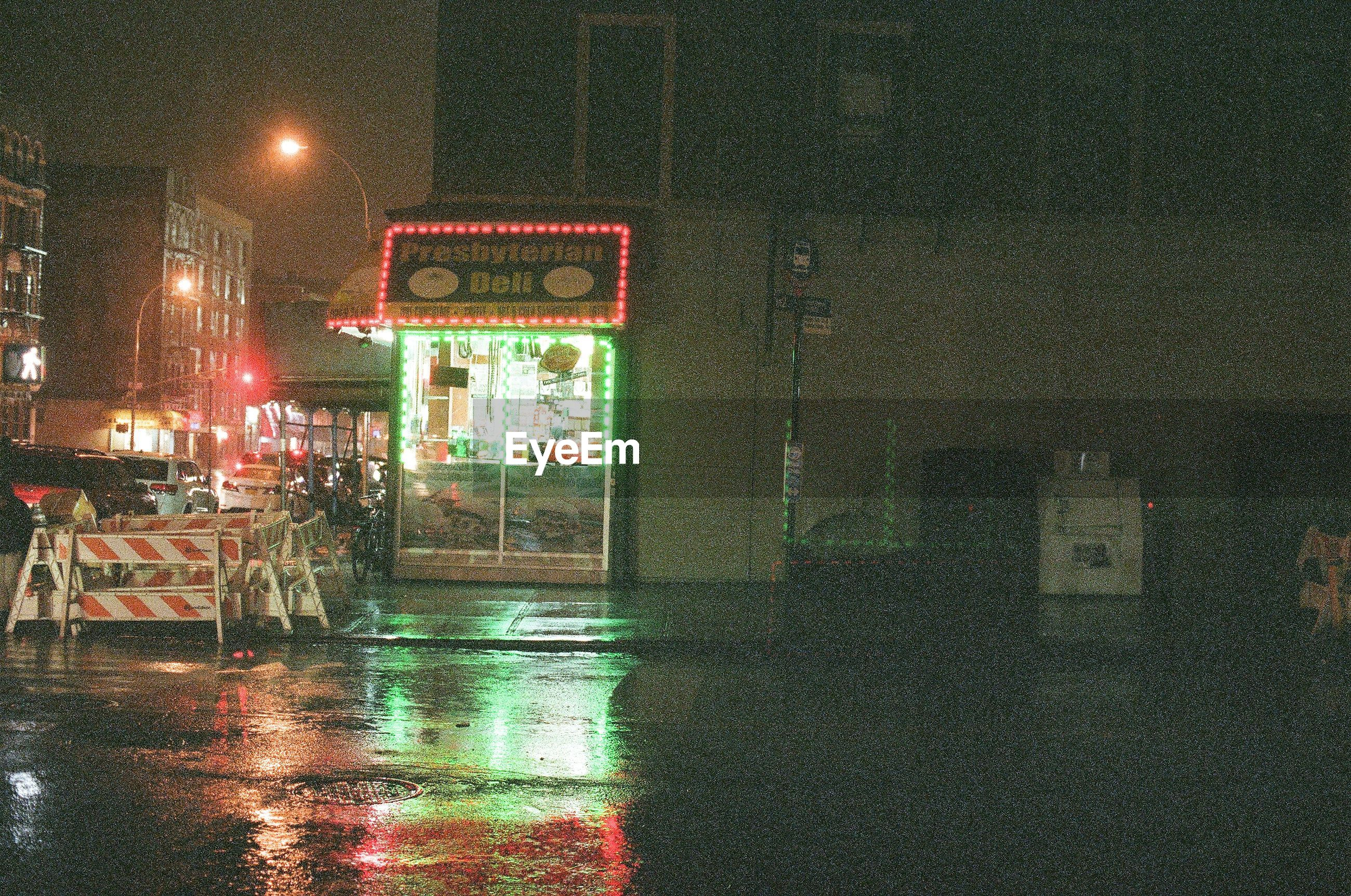 reflection, illuminated, no people, text, multi colored, communication, wet, water, night, outdoors