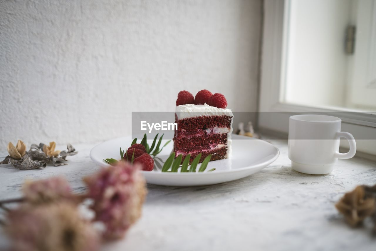 food and drink, freshness, food, sweet food, indoors, still life, plate, table, cup, sweet, dessert, mug, ready-to-eat, selective focus, indulgence, no people, strawberry, coffee cup, baked, drink, temptation, crockery, breakfast