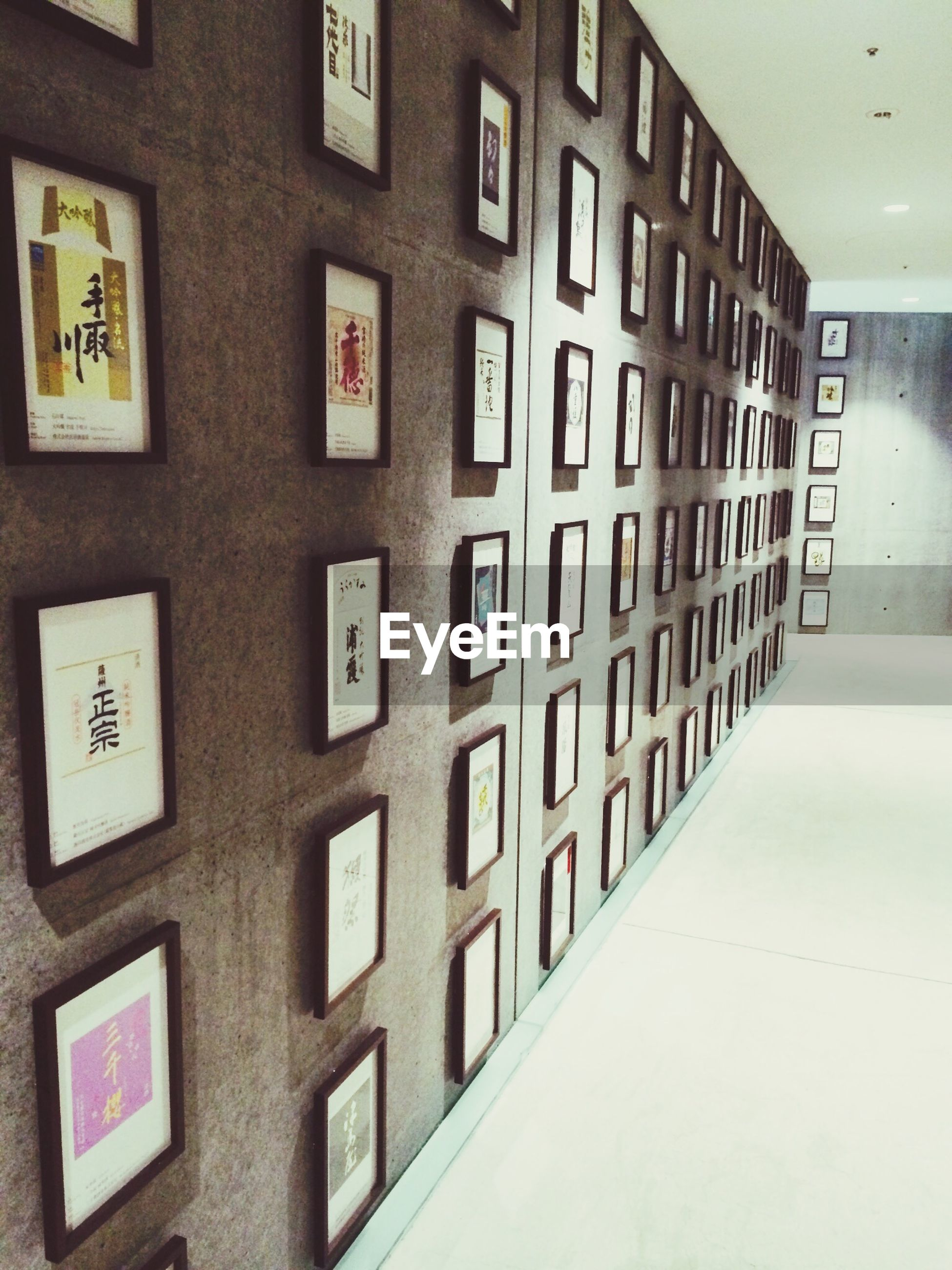 architecture, indoors, built structure, window, wall - building feature, door, in a row, building exterior, building, wall, text, full frame, no people, repetition, pattern, communication, backgrounds, closed, western script, number