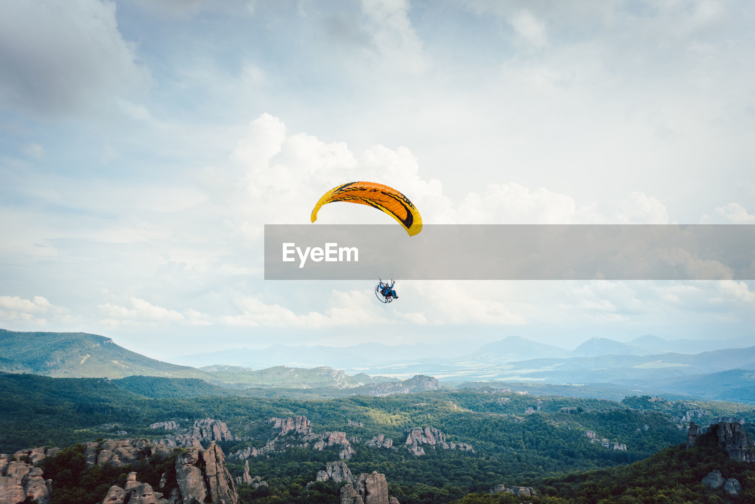PARAGLIDING AGAINST SKY