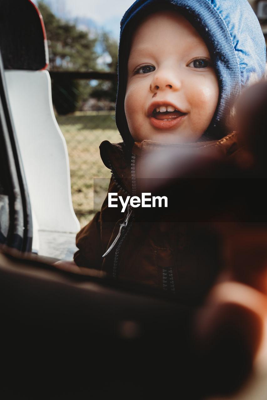 Portrait of cute boy looking away