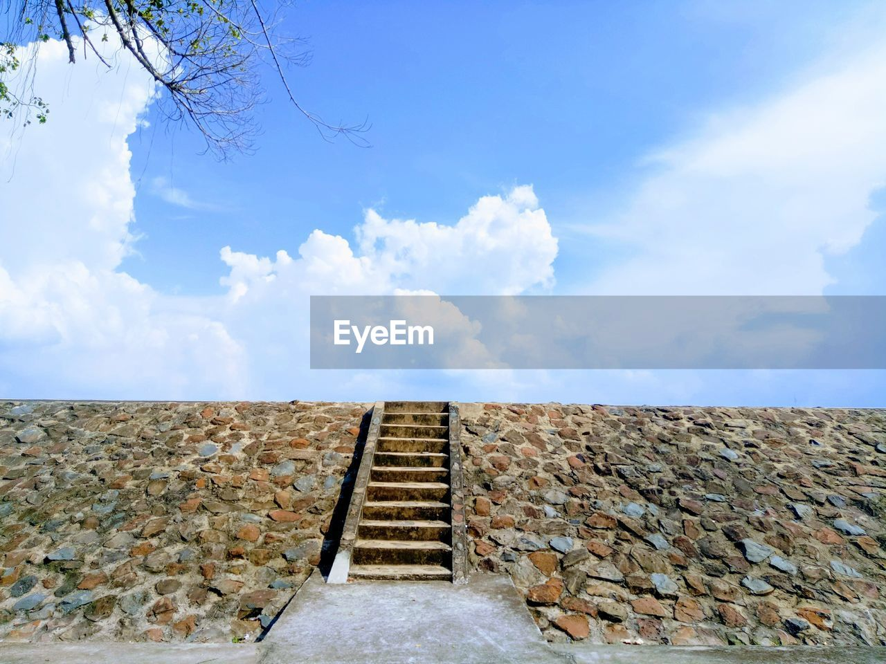 sky, cloud - sky, architecture, built structure, day, wall, nature, no people, stone wall, low angle view, wall - building feature, direction, outdoors, building exterior, staircase, the way forward, building, blue, beauty in nature, solid