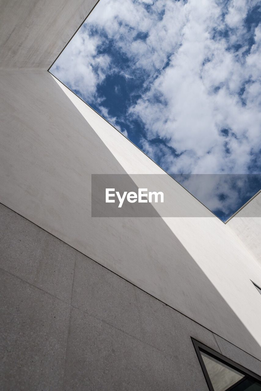 architecture, low angle view, built structure, building exterior, sky, day, no people, outdoors, modern
