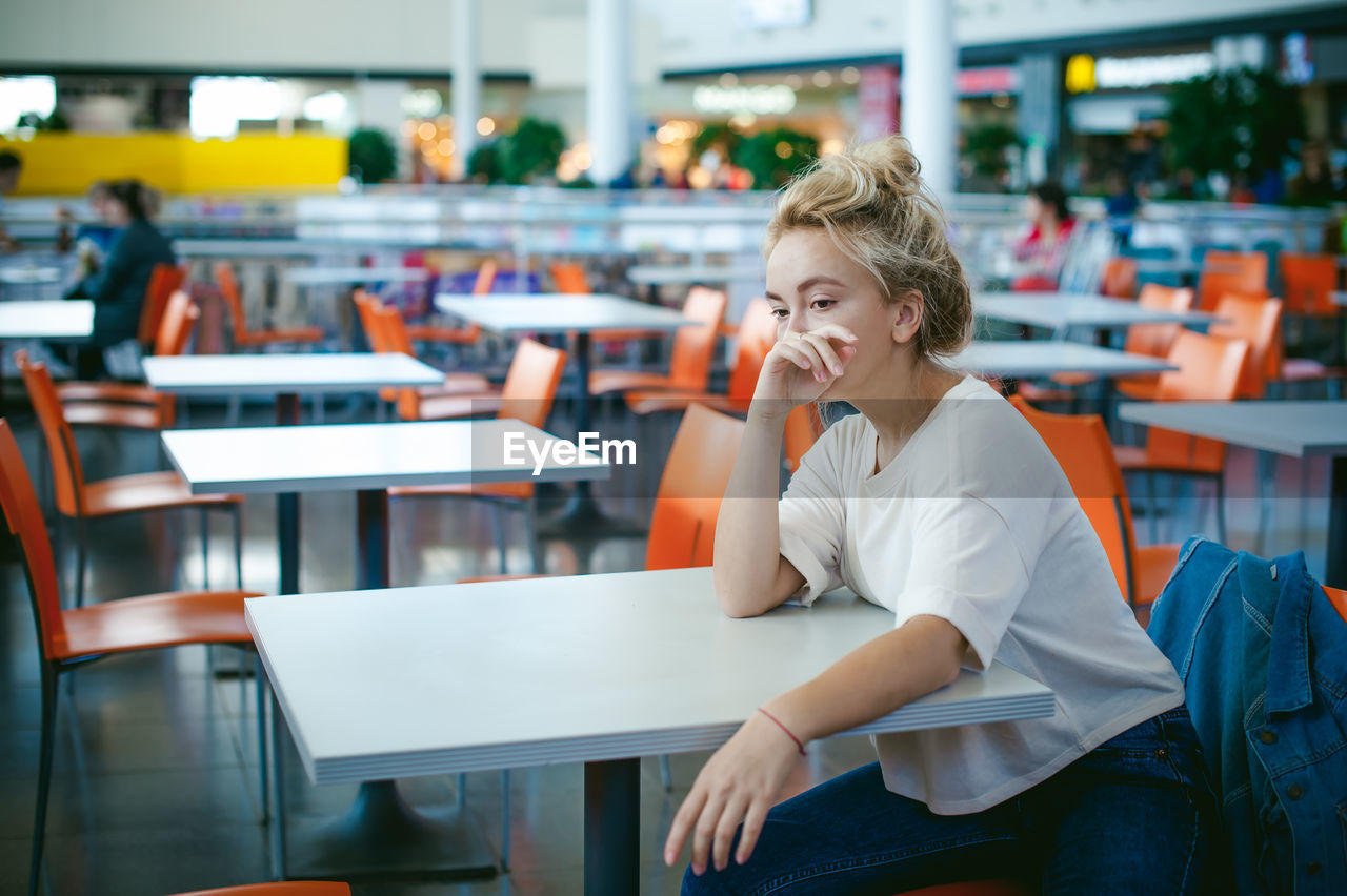 Woman Sitting On Chair At Supermarket