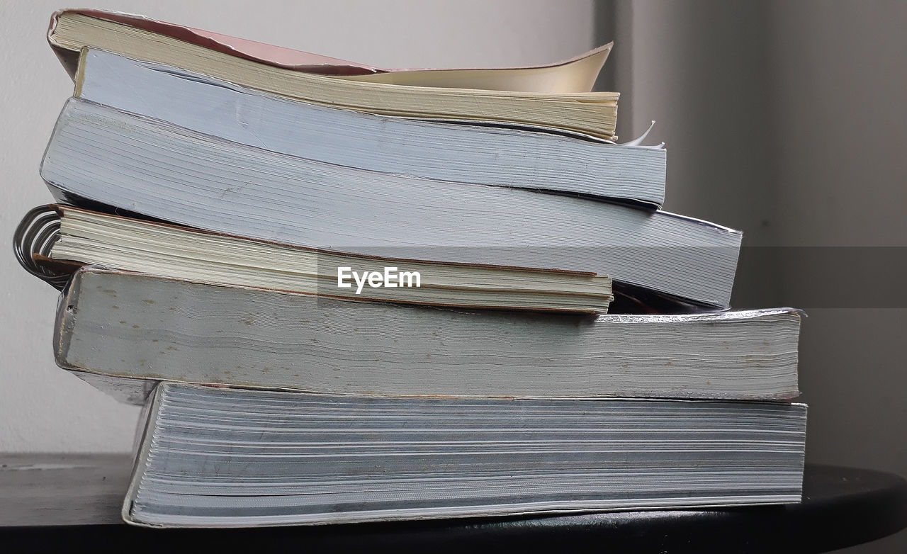Close-up of stacked books