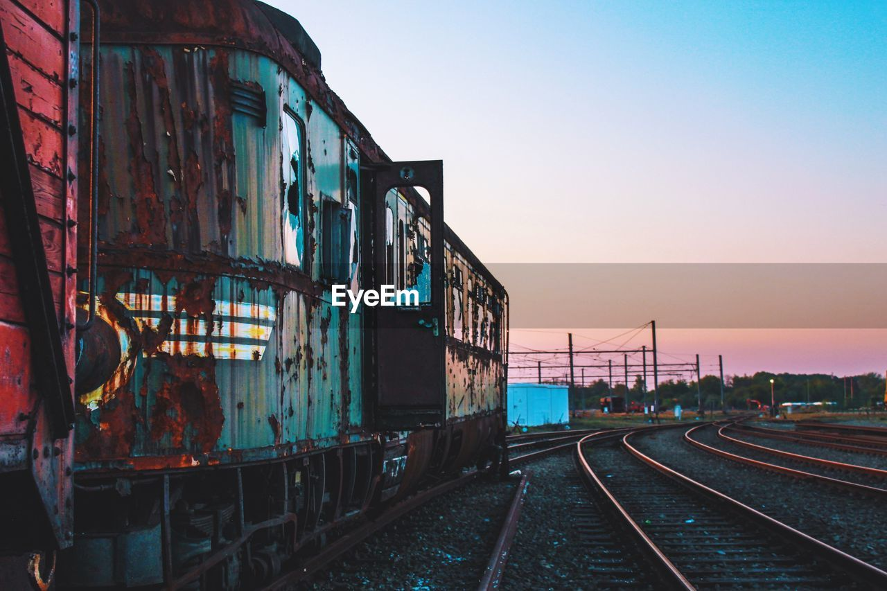 Abandoned Train On Railroad Tracks