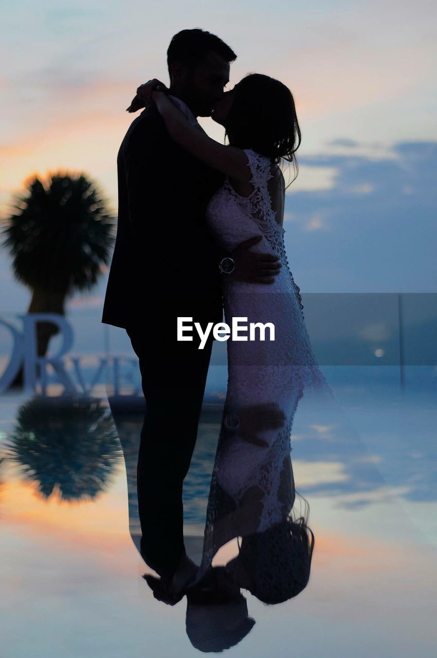 love, two people, sky, sunset, real people, cloud - sky, togetherness, outdoors, young women, full length, women, men, leisure activity, lifestyles, standing, water, couple - relationship, young adult, bonding, sea, beauty in nature, day