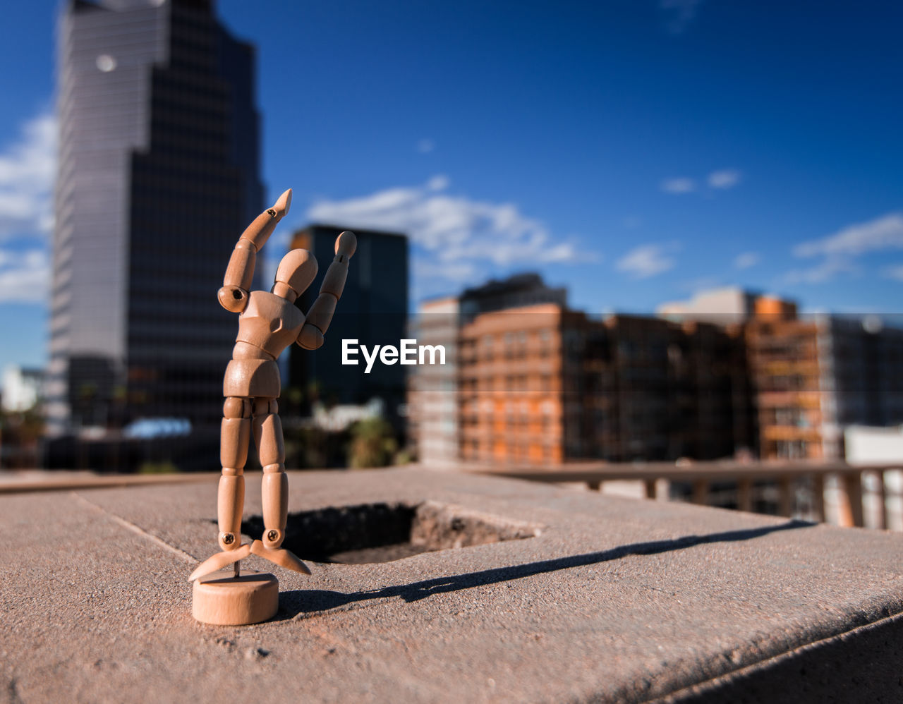 Wooden Figurine On Wall During Sunny Day