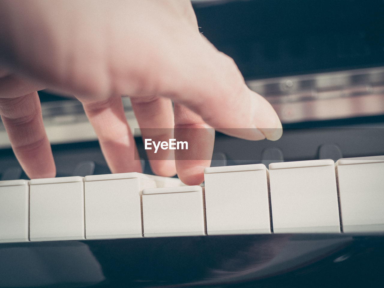 Close-Up Of The Hand Of A Pianist
