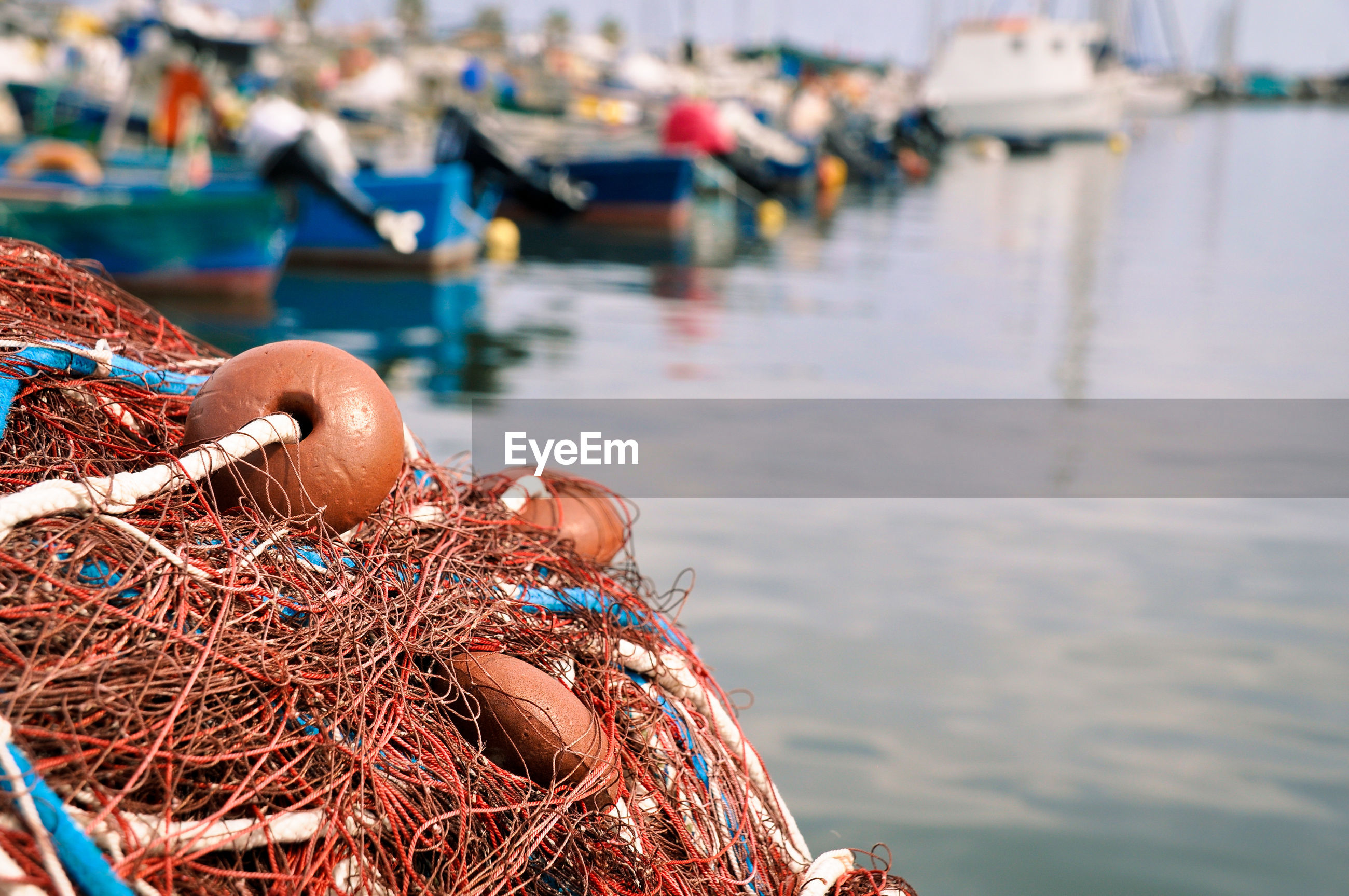 Close-up of fishing net in harbor