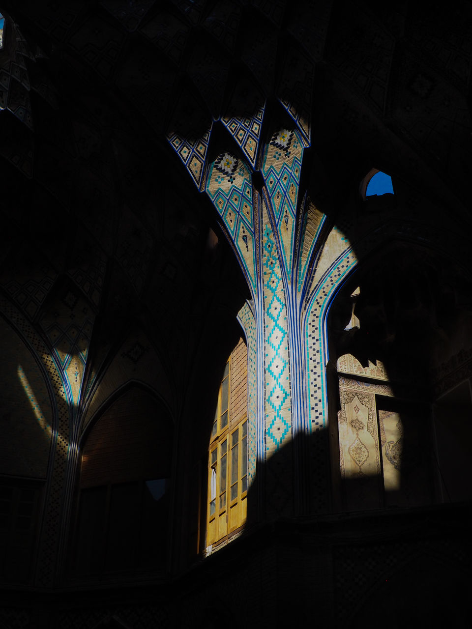 arch, indoors, religion, spirituality, place of worship, built structure, architecture, no people, day, low angle view, multi colored