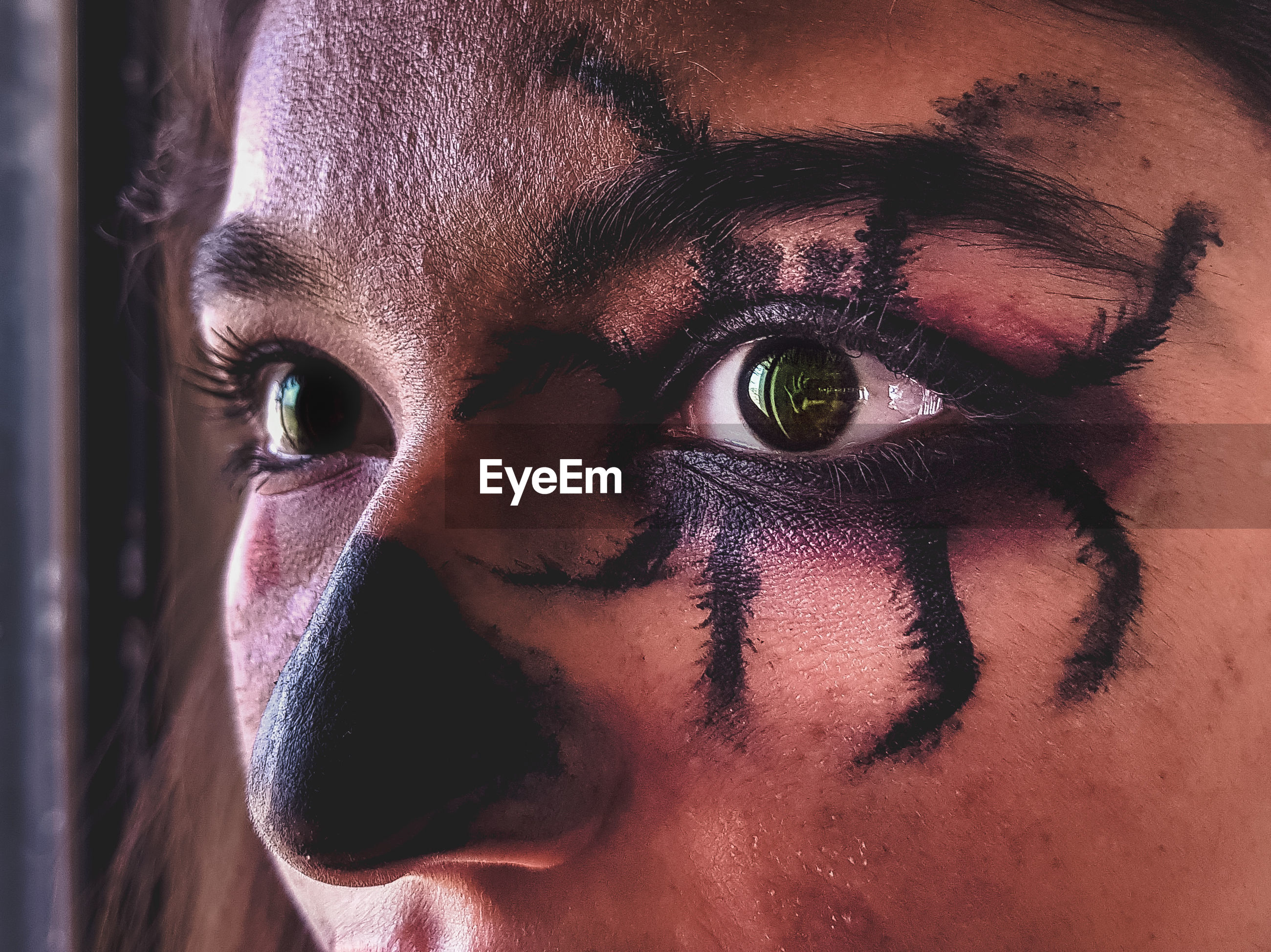 Cropped image of woman with spooky make-up during halloween