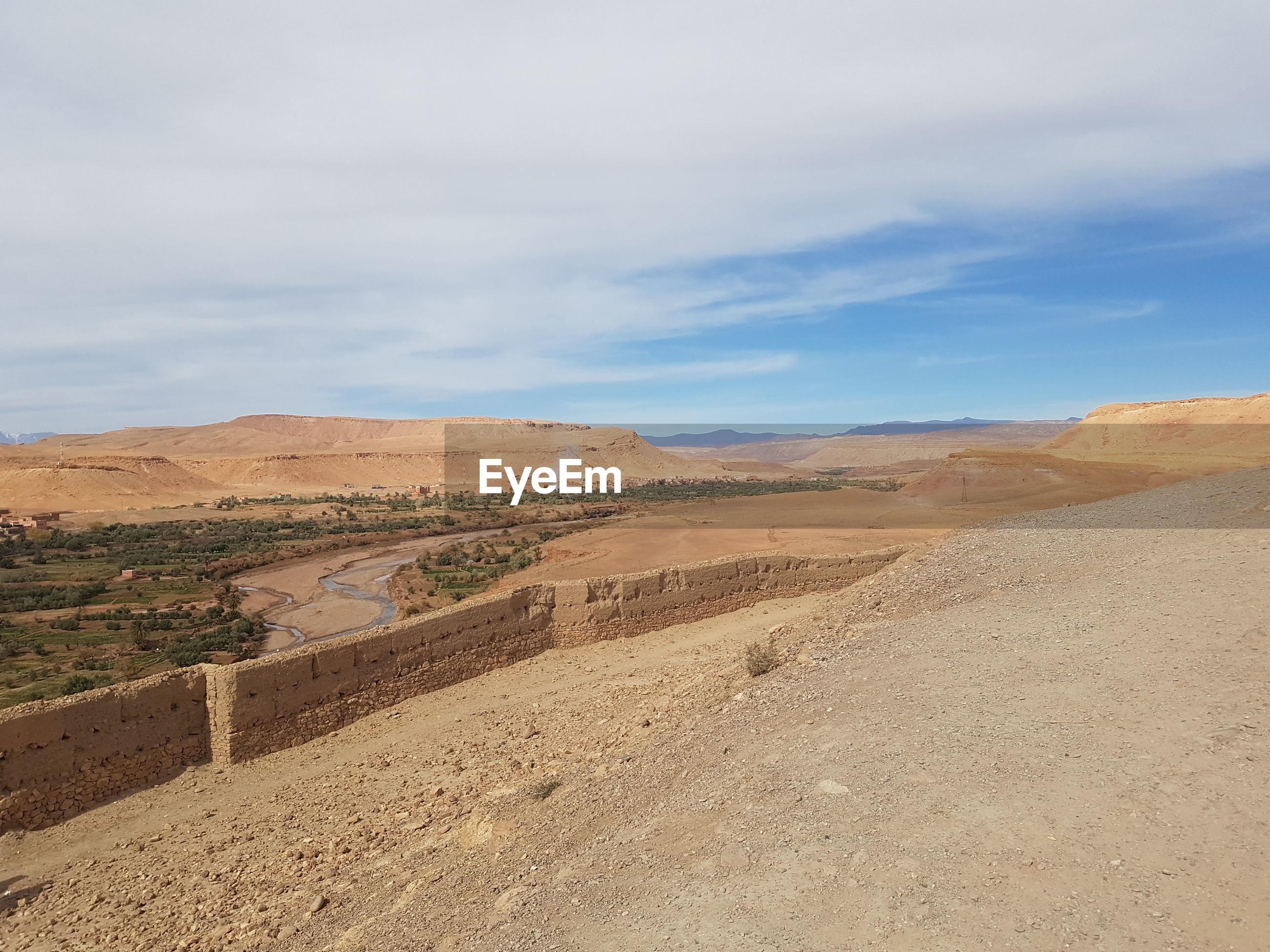 VIEW OF DESERT ROAD AGAINST SKY