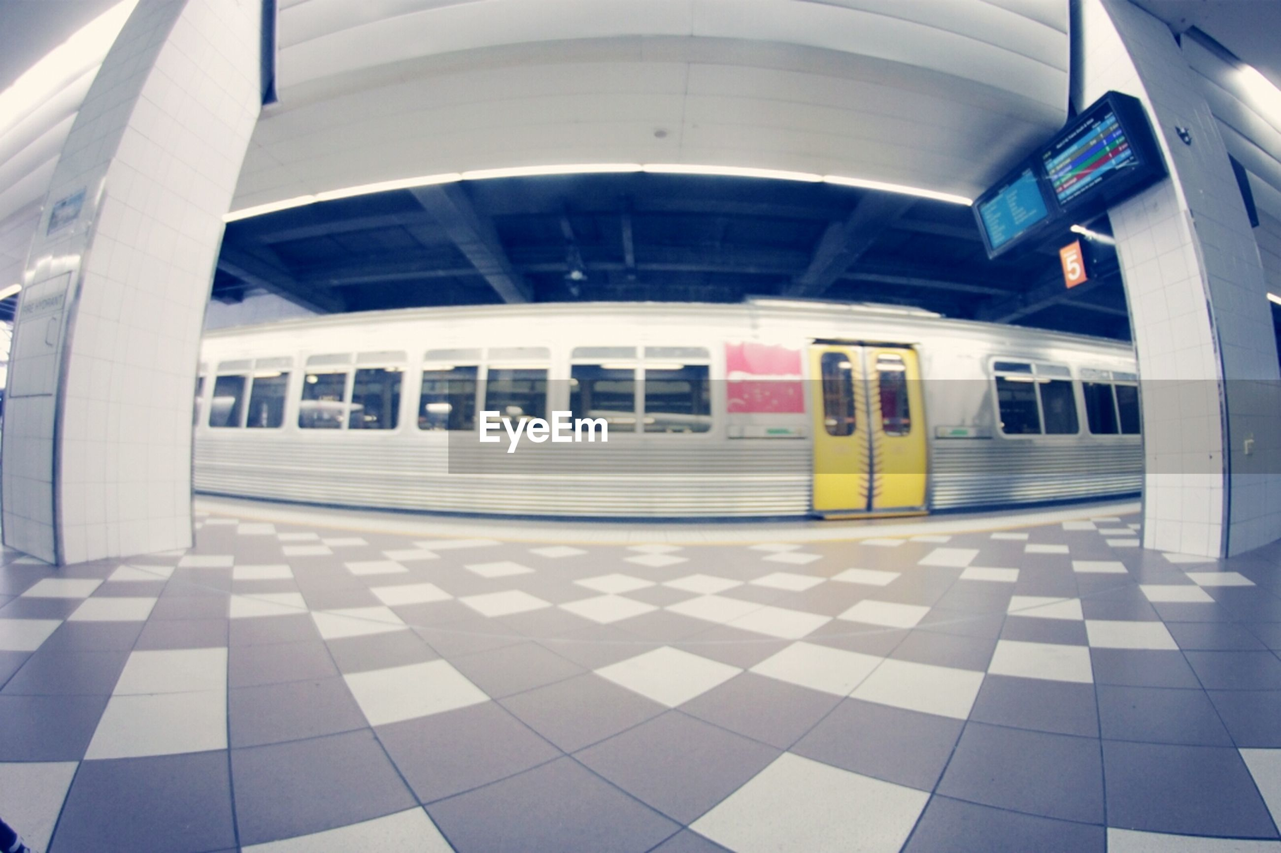 transportation, architecture, built structure, mode of transport, window, public transportation, reflection, building exterior, indoors, glass - material, travel, day, railroad station, modern, empty, land vehicle, building, city, incidental people, no people