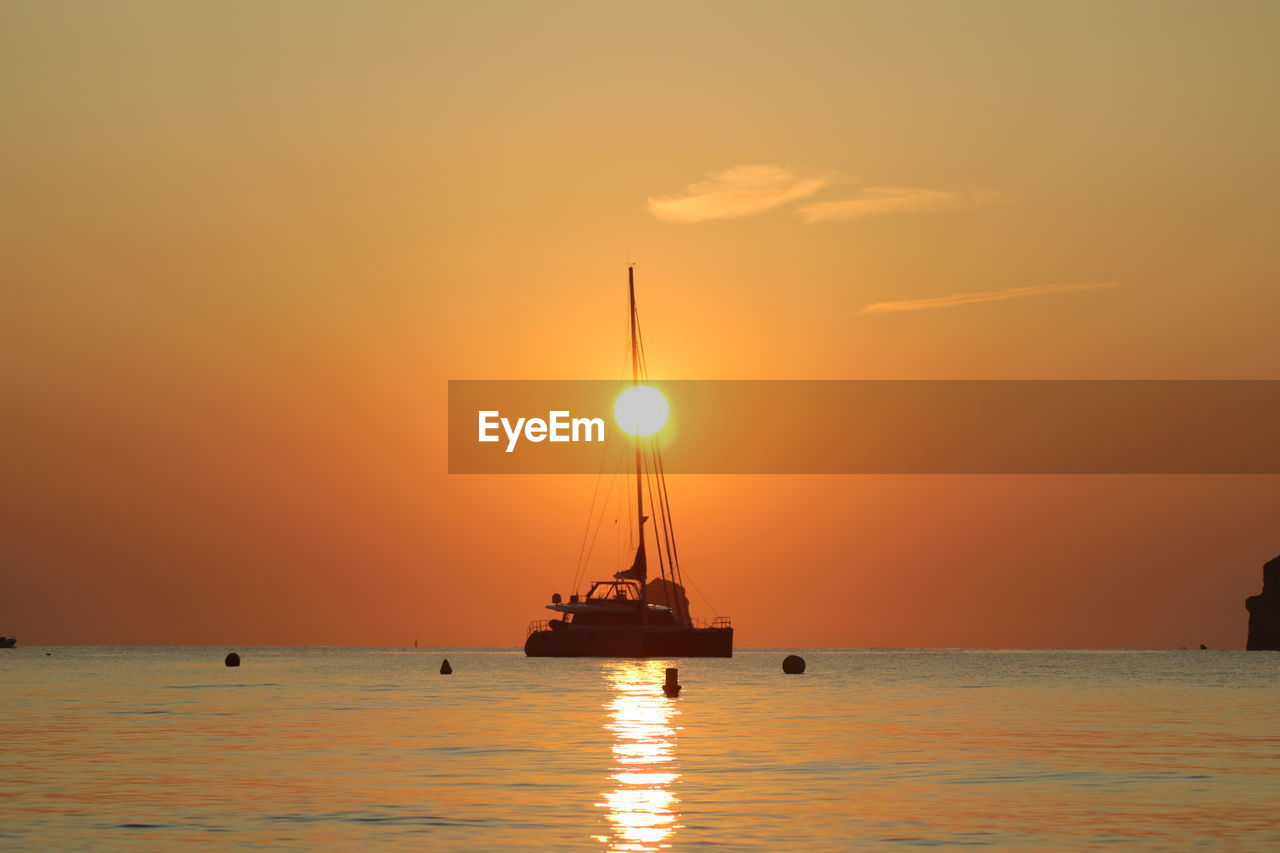 water, sea, sky, sunset, nautical vessel, scenics - nature, transportation, orange color, beauty in nature, sun, waterfront, horizon over water, mode of transportation, tranquil scene, horizon, idyllic, nature, silhouette, no people, outdoors, sailboat